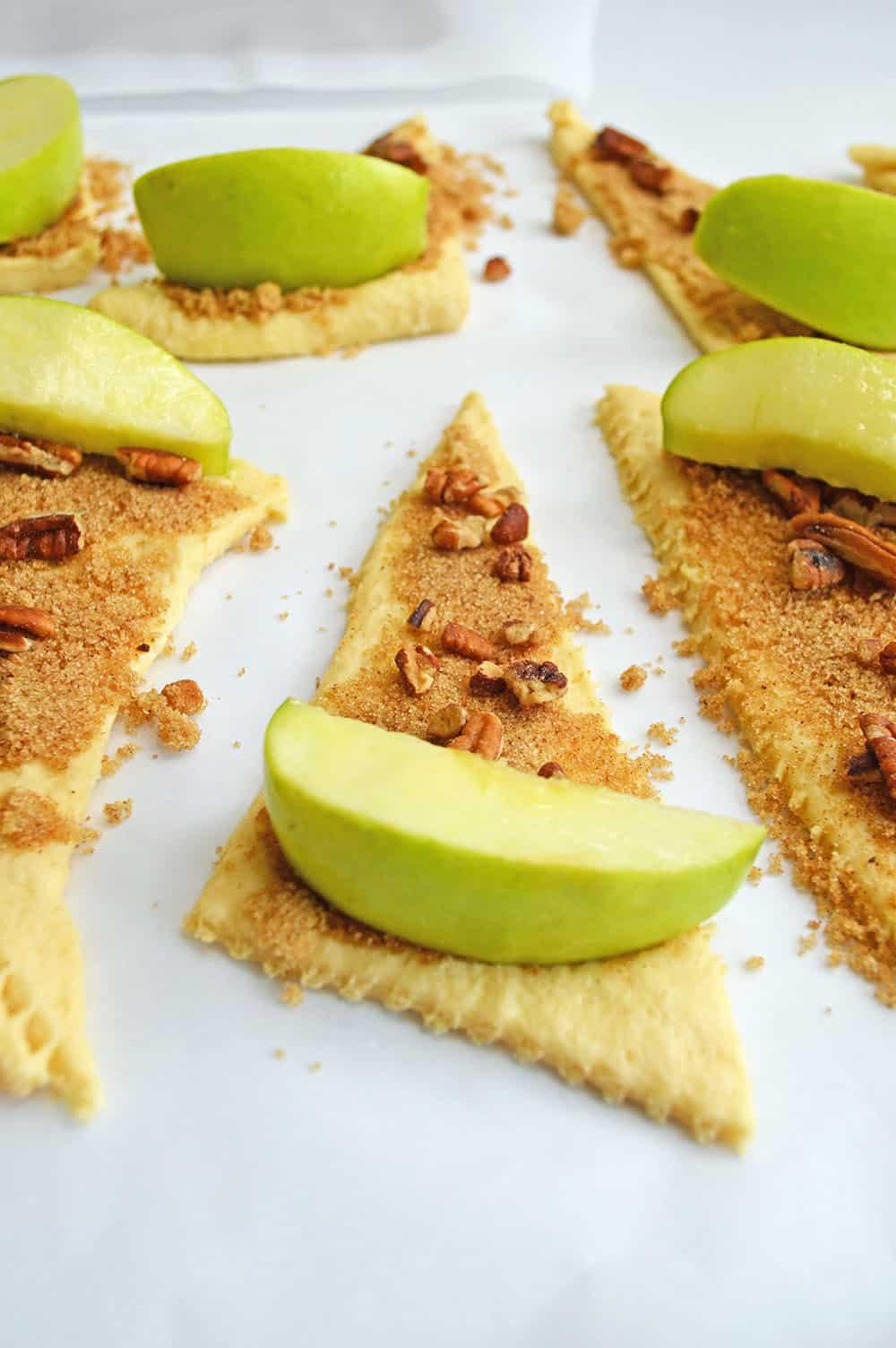 apple on cinnamon sugar and dough
