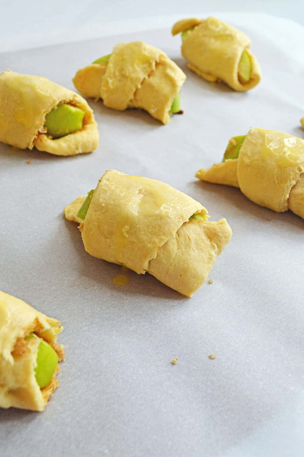 wrap the apples in a crescent roll