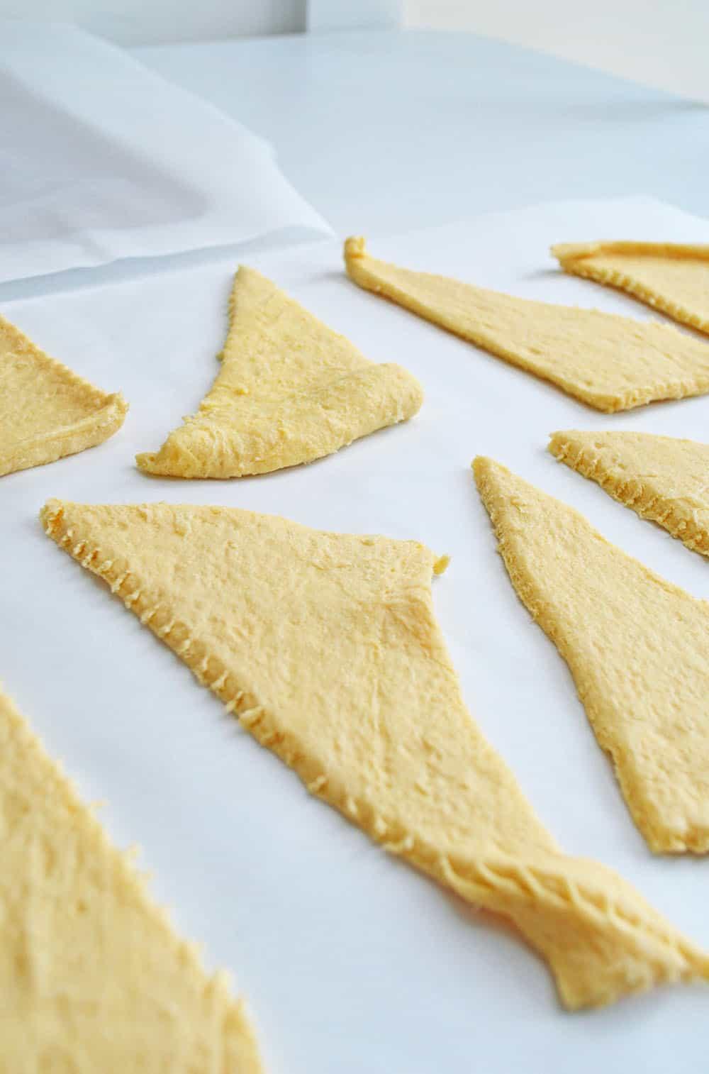 crescent dough on a baking sheet