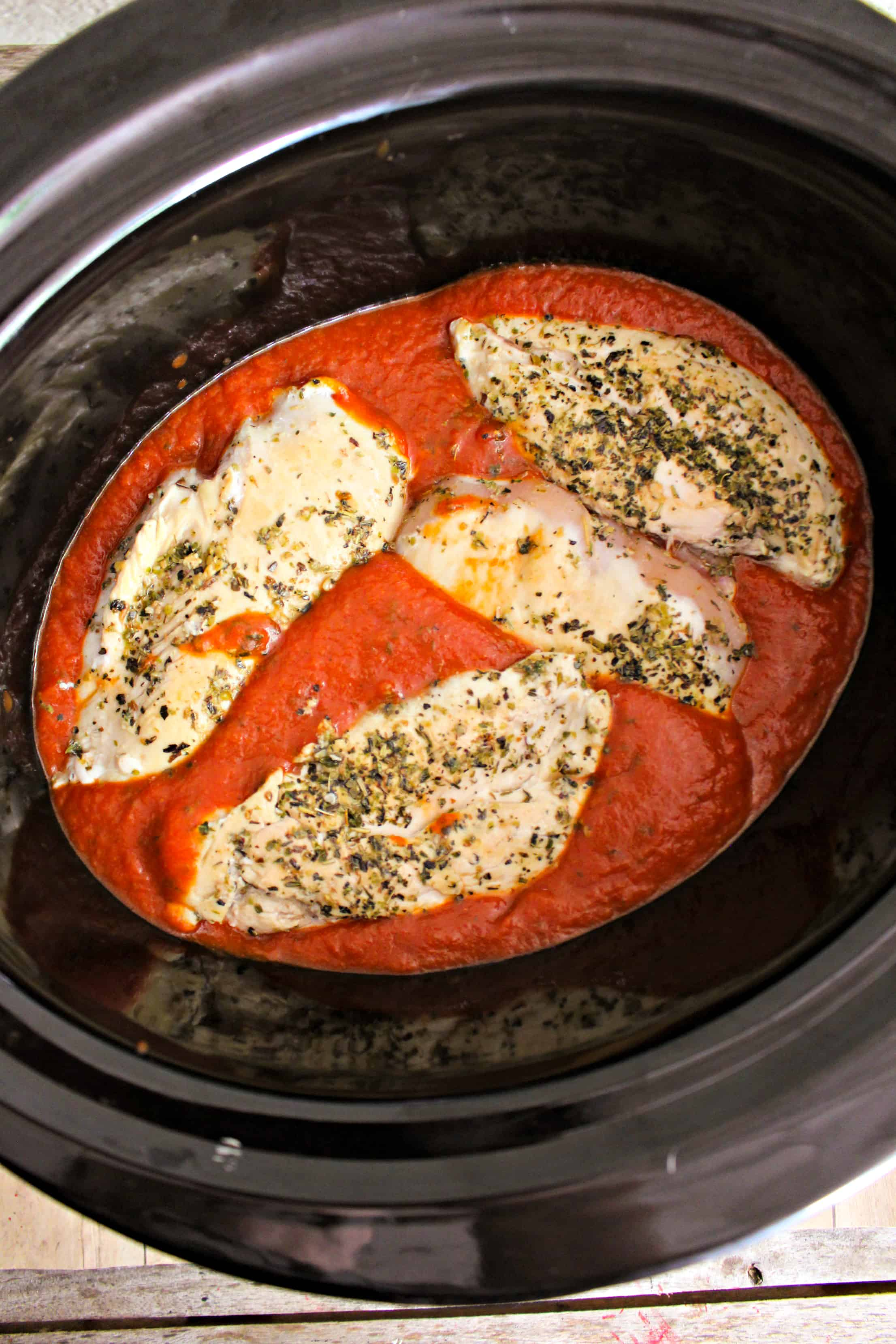 sauce and chicken in the slow cooker
