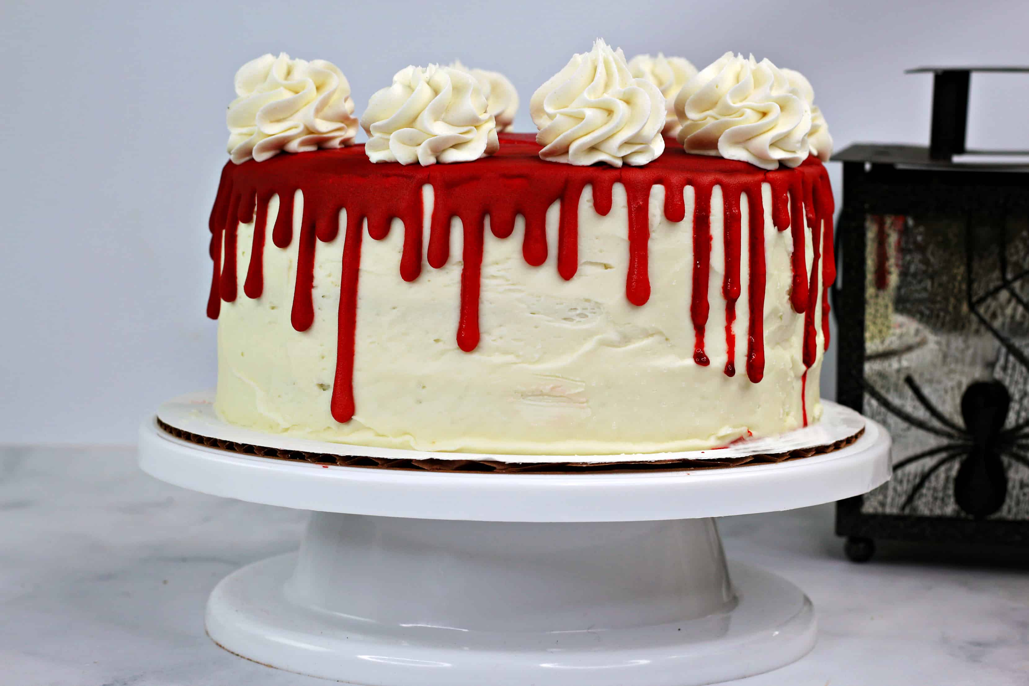 whole cake with vampire blood down the side for a Halloween cake recipe