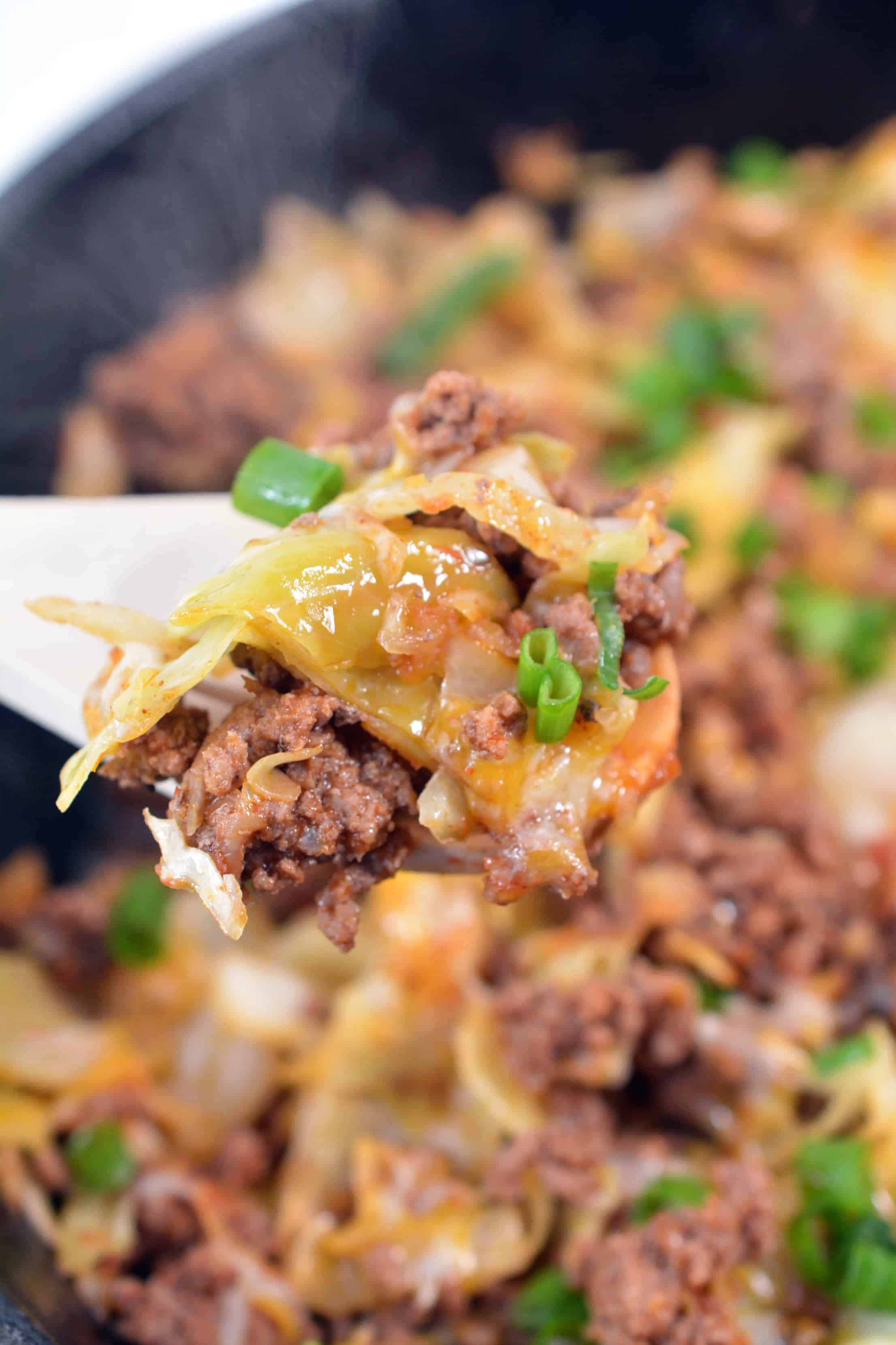 easy taco recipe with beef and cabbage on a spoon