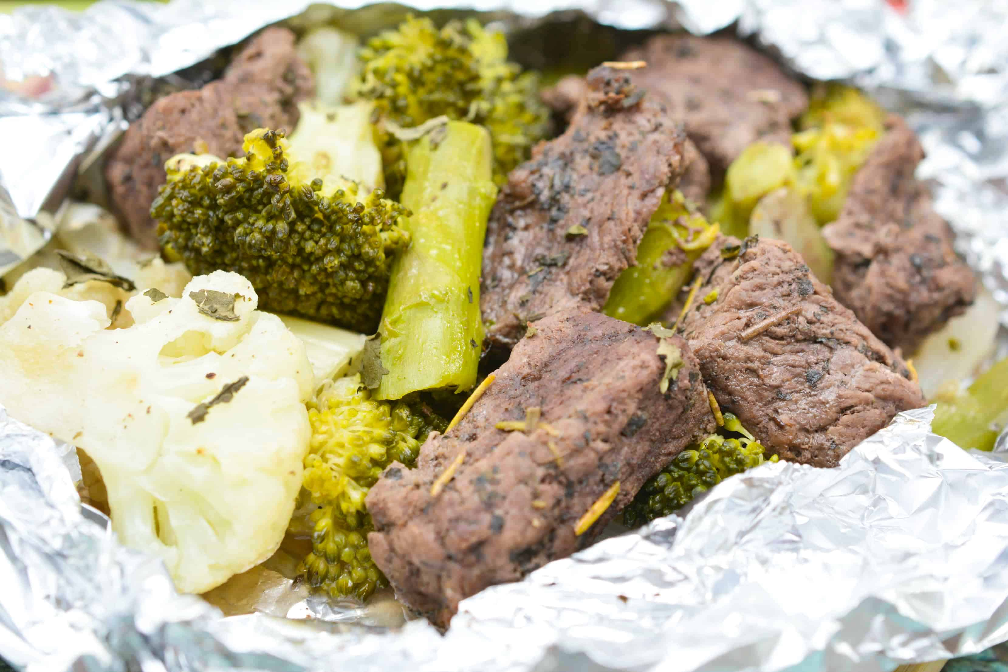 steak and vegetables in a foil packet