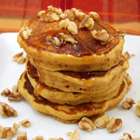 pumpkin pancakes with nuts and syrup