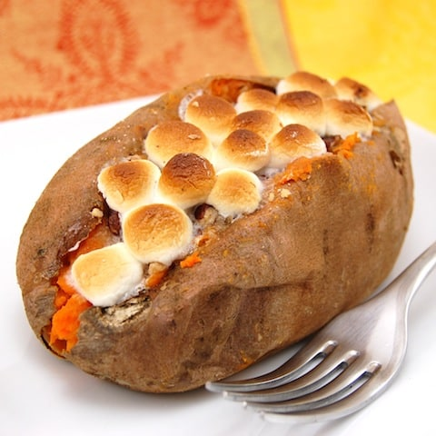 stuffed sweet potato on a plate with a fork