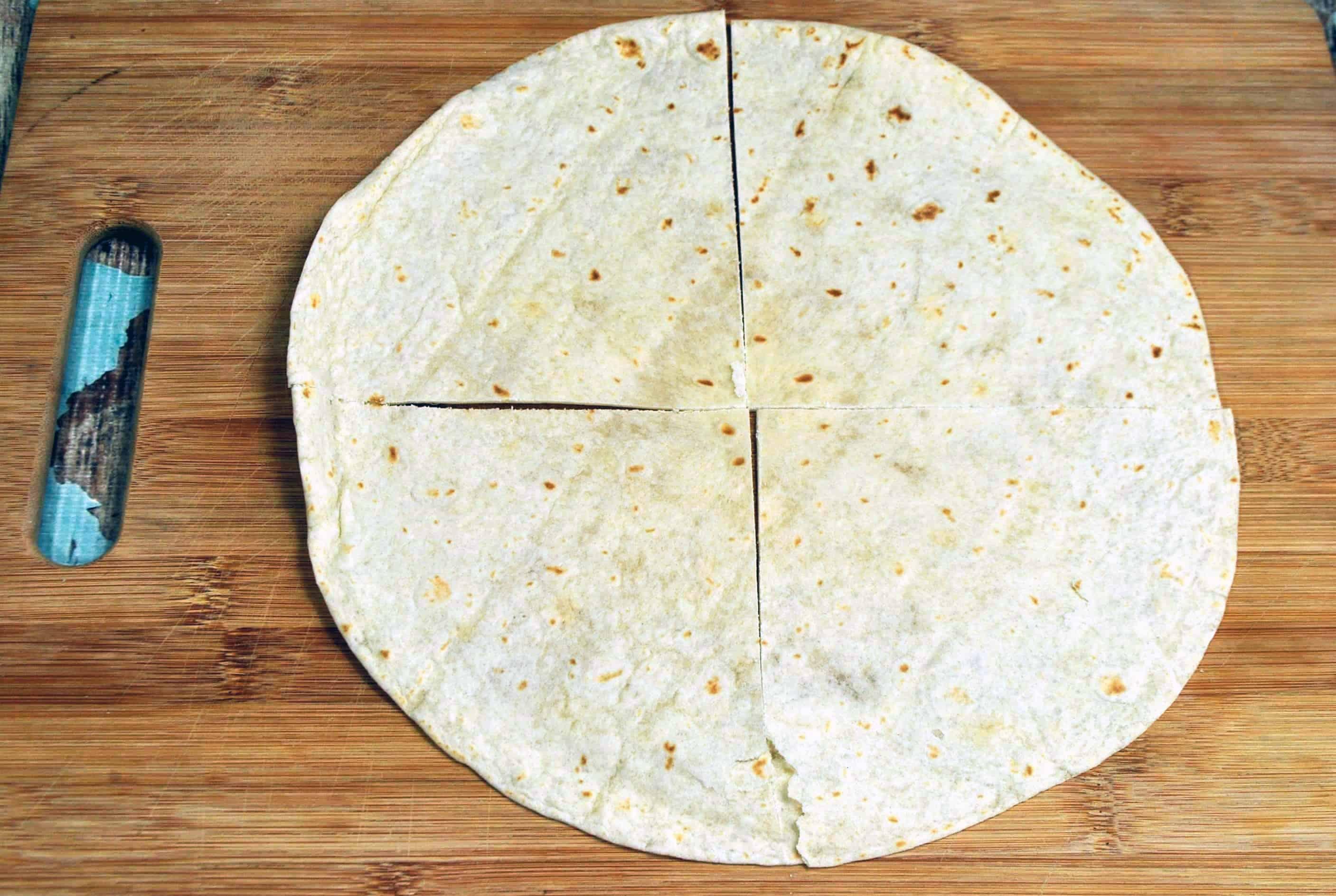 cut the tortilla into 4 pieces