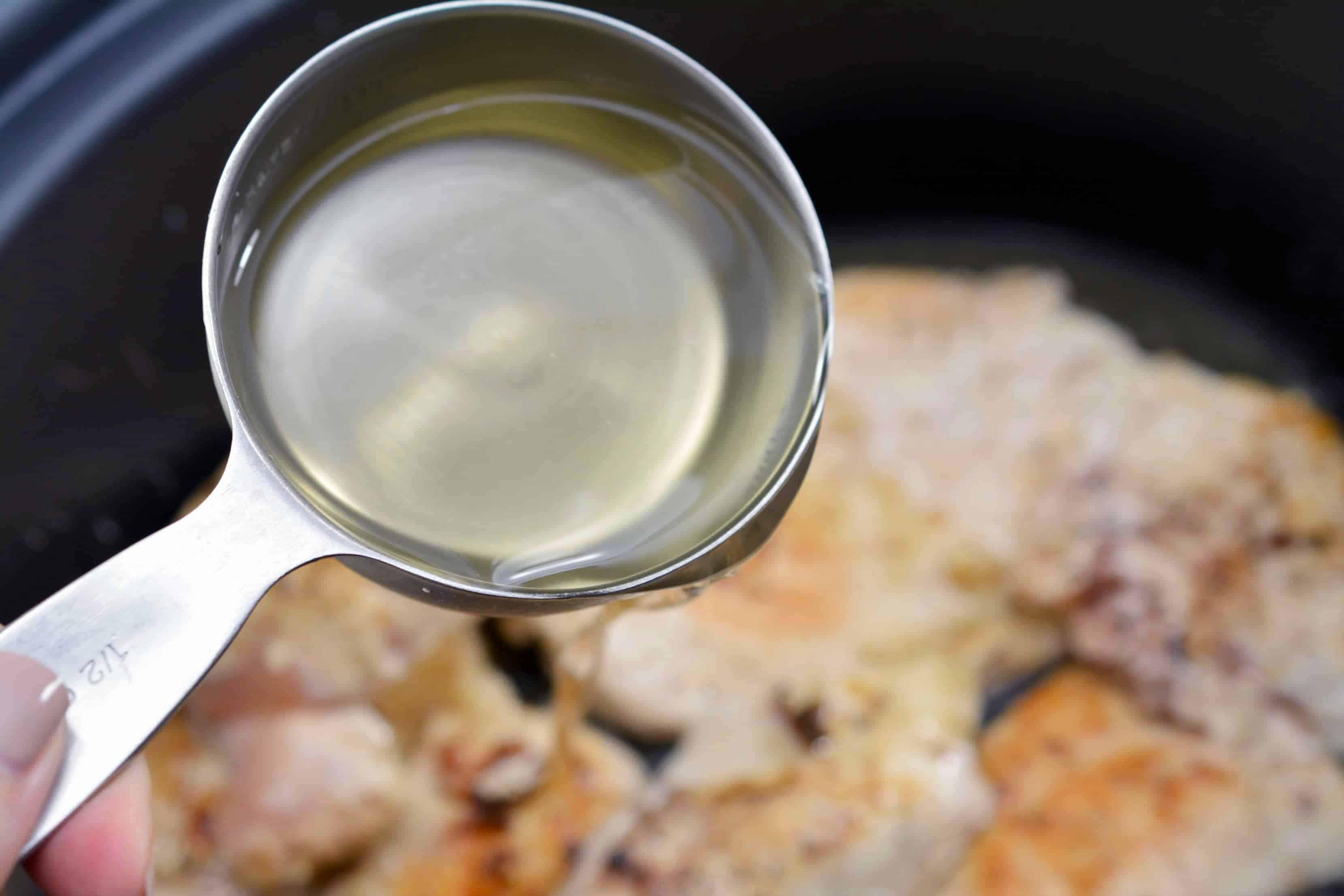 add white wine to the chicken