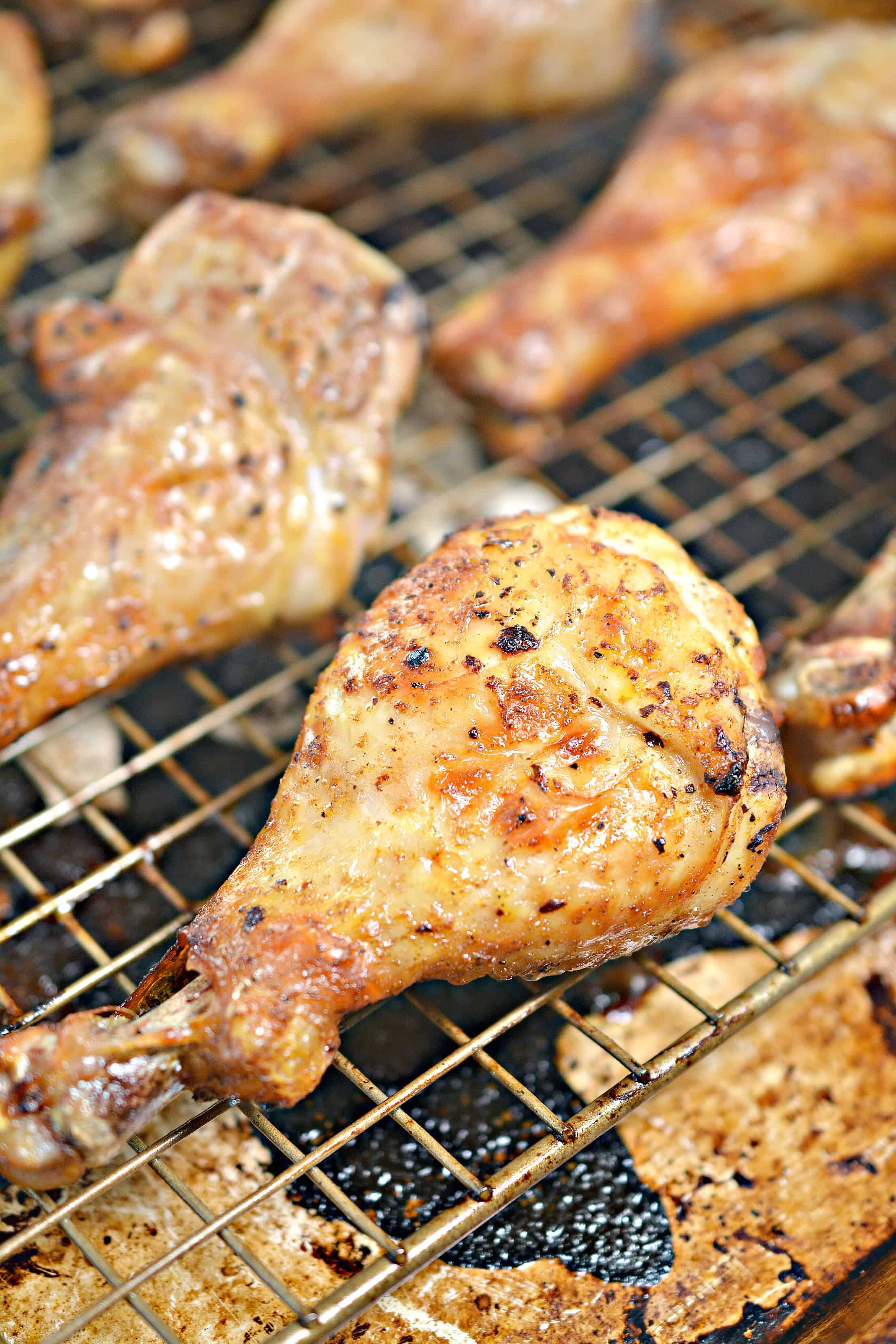 Brown Sugar Glazed Baked Chicken Drumsticks on a wire rack