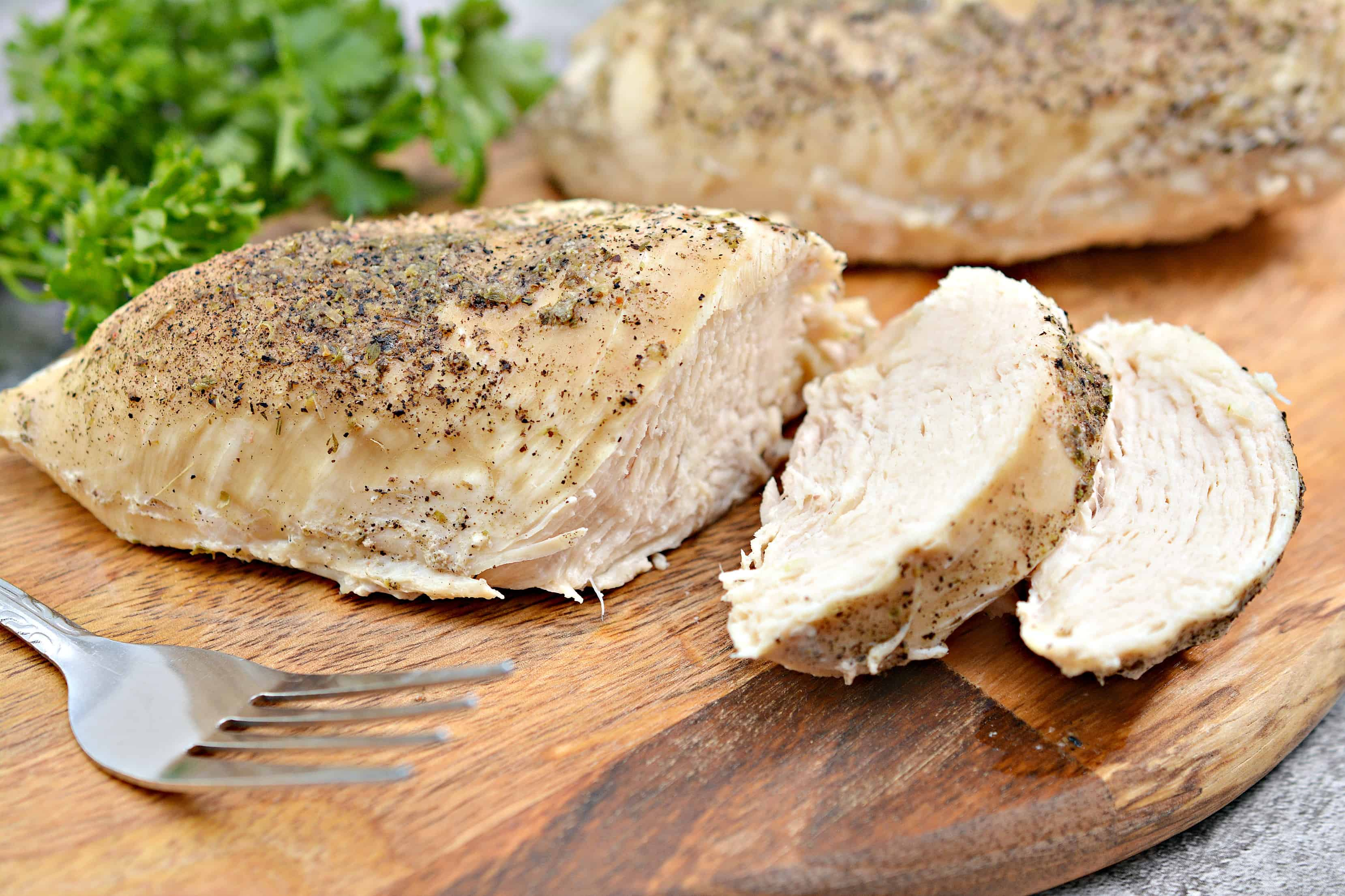 cooked chicken on the cutting board