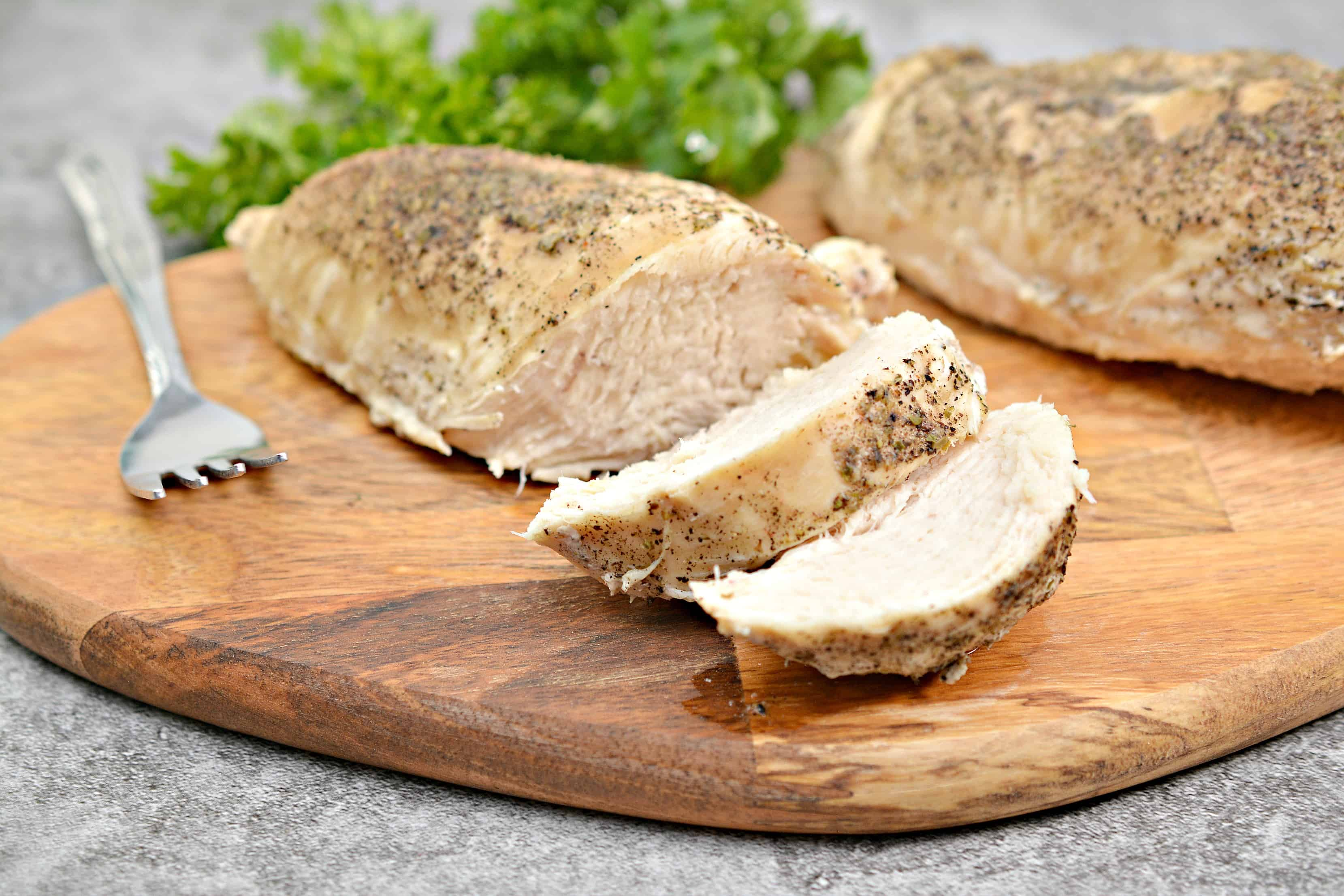 cooked chicken on a cutting board
