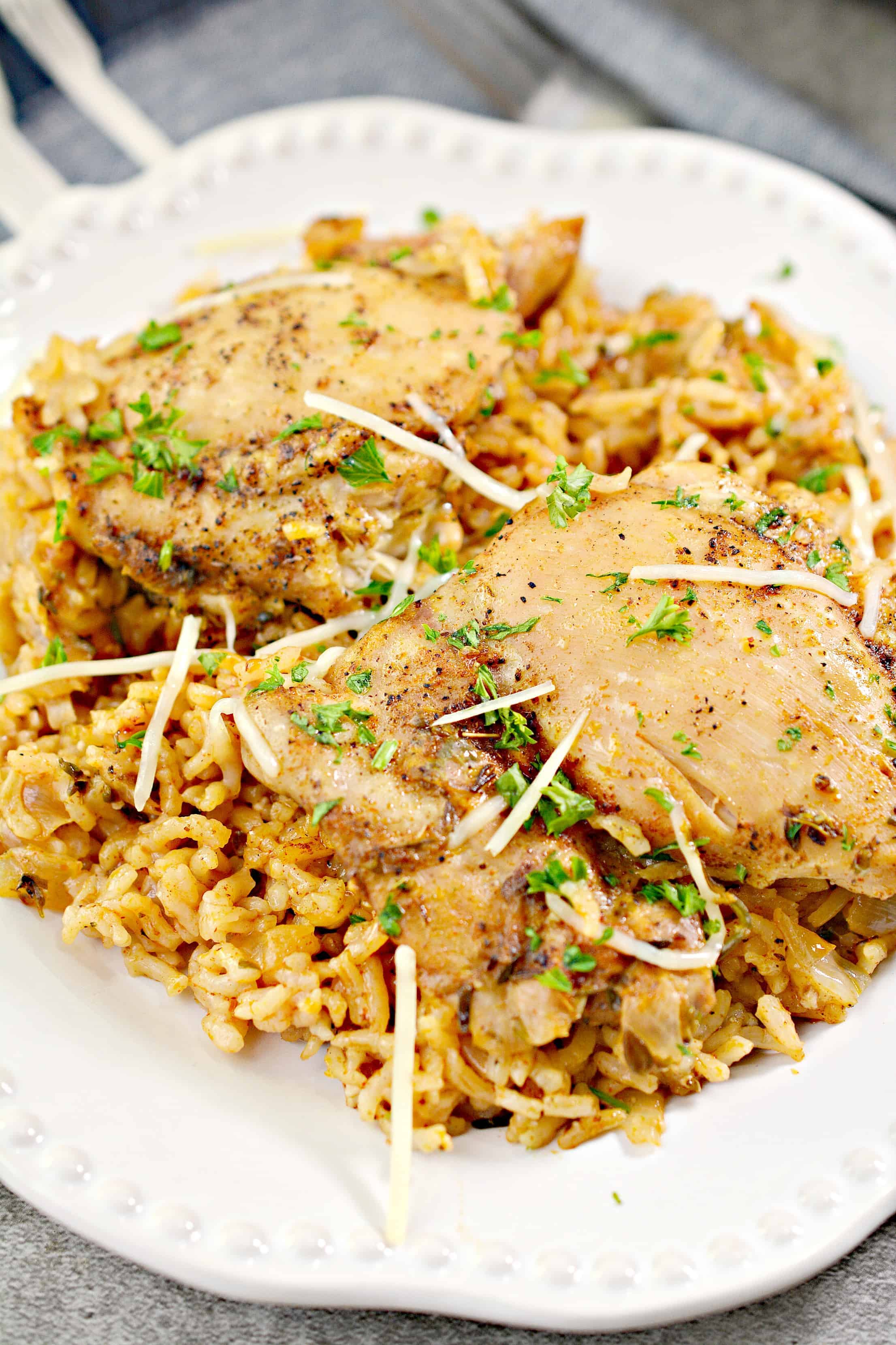 chicken with garlic sauce over rice