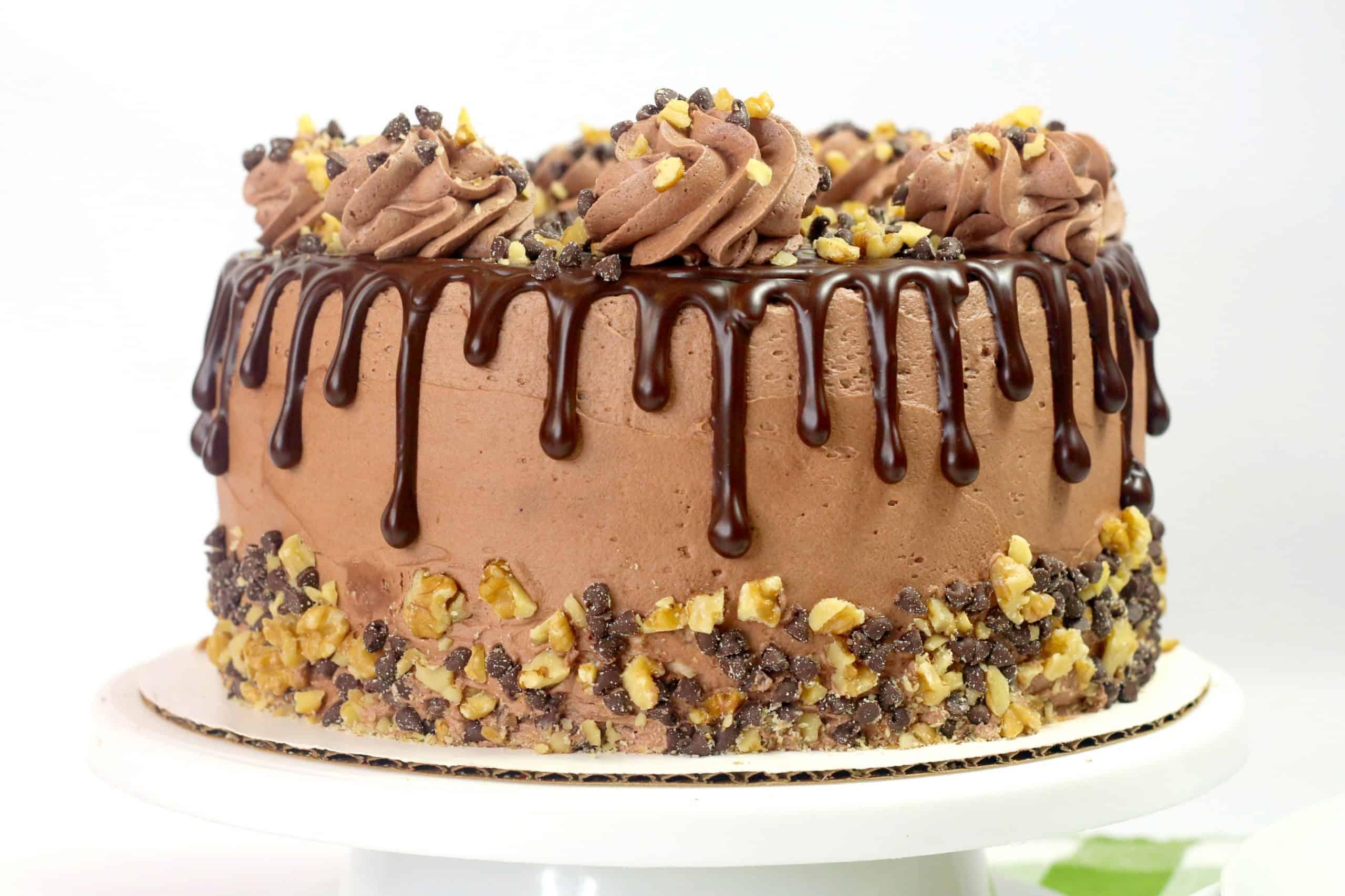 whole chocolate fudge cake on a cake board