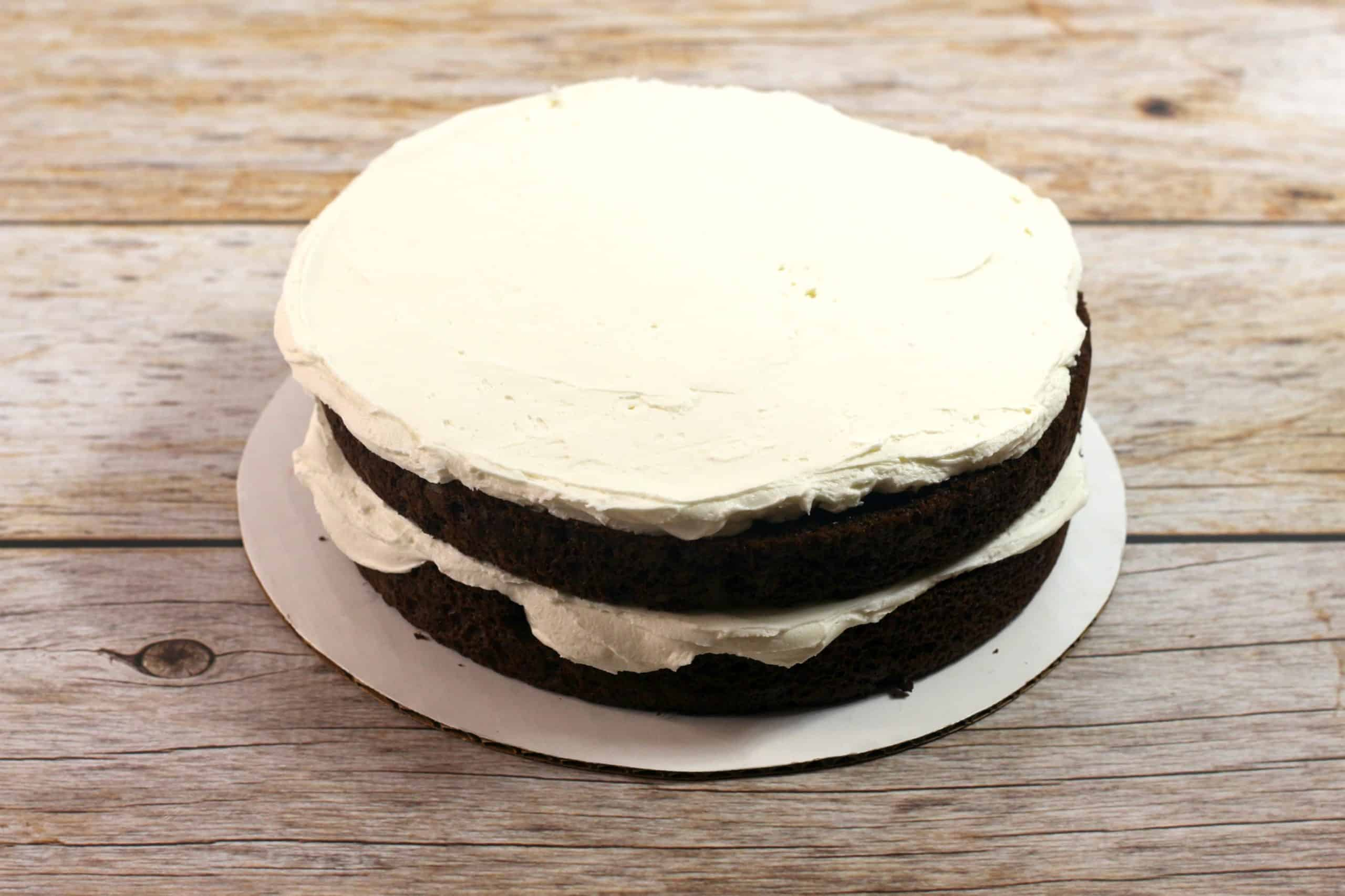 2 layers of cake with vanilla frosting