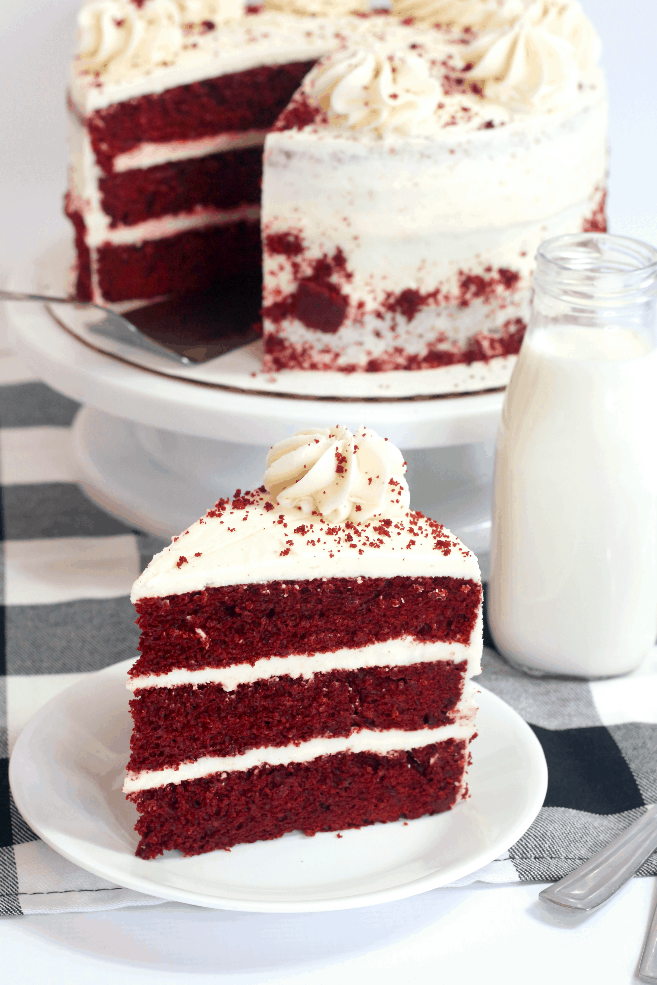 slice ov red velvet cake on a white plate