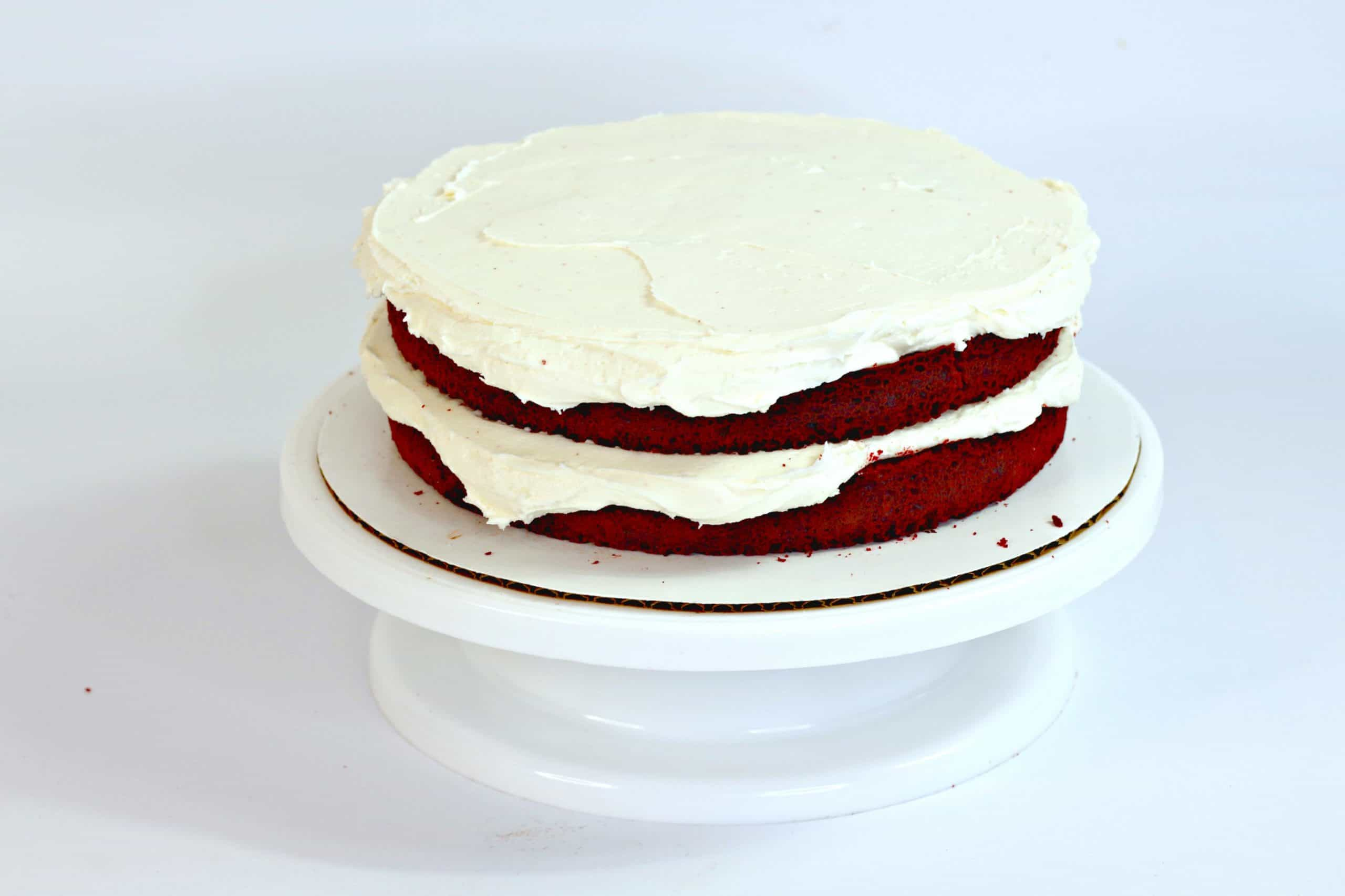 2 cake layers with cream cheese frosting