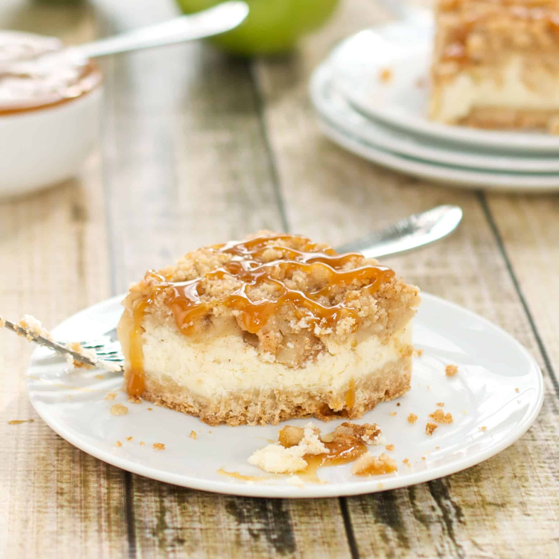 caramel apple cheesecake bars on a white plate