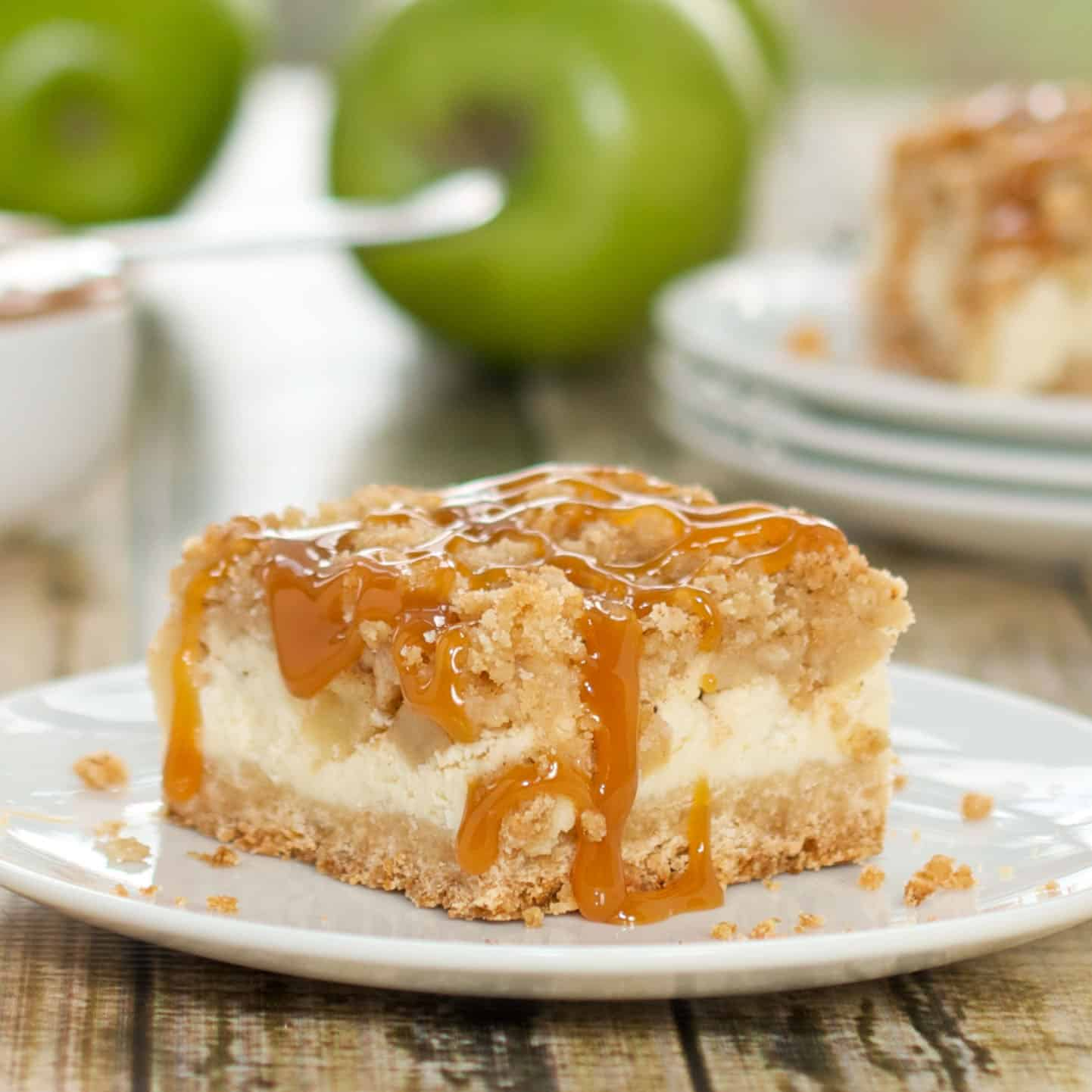 caramel apple cheesecake bar on a white plate