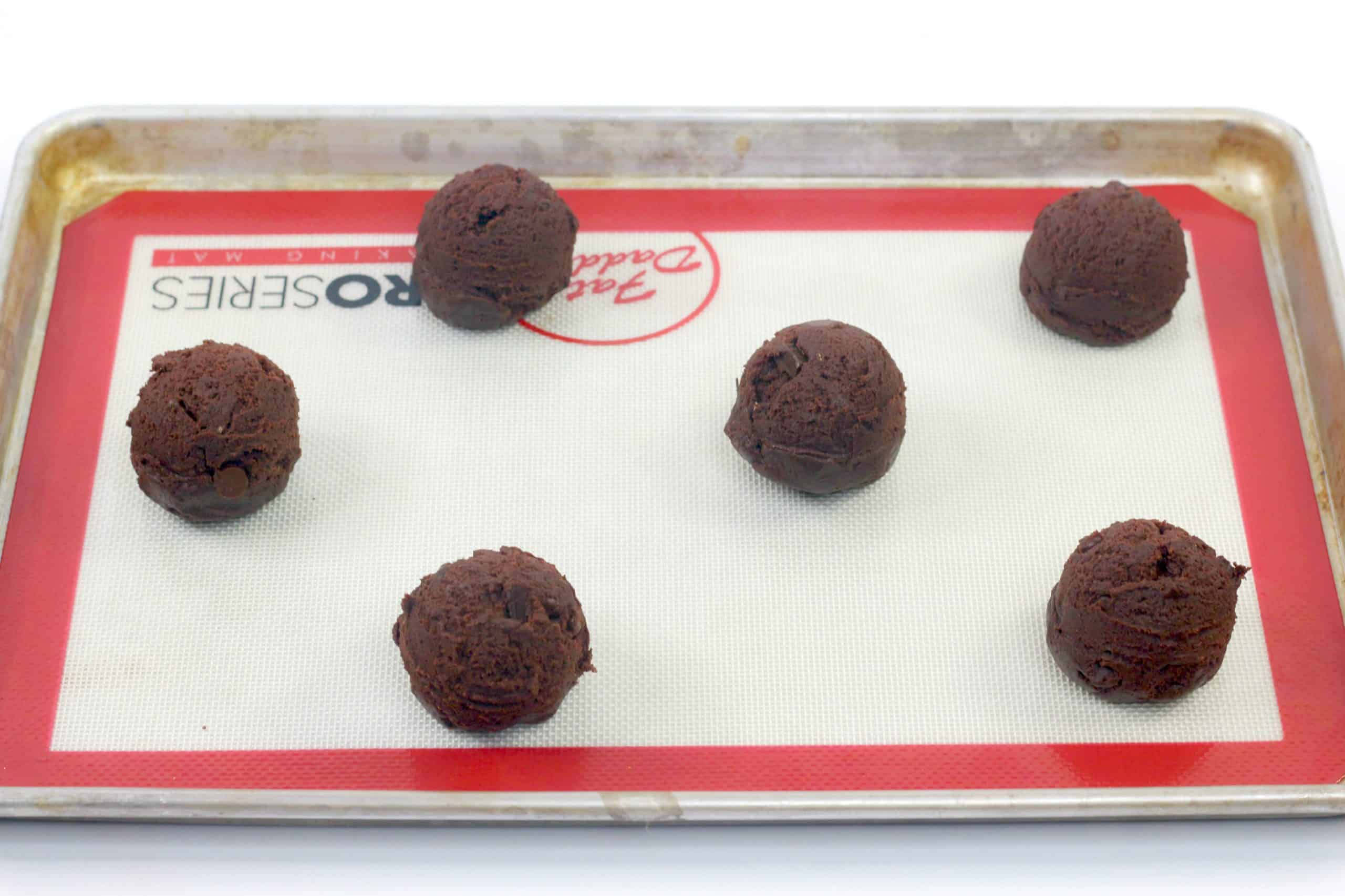 unbaked cookie balls on pan
