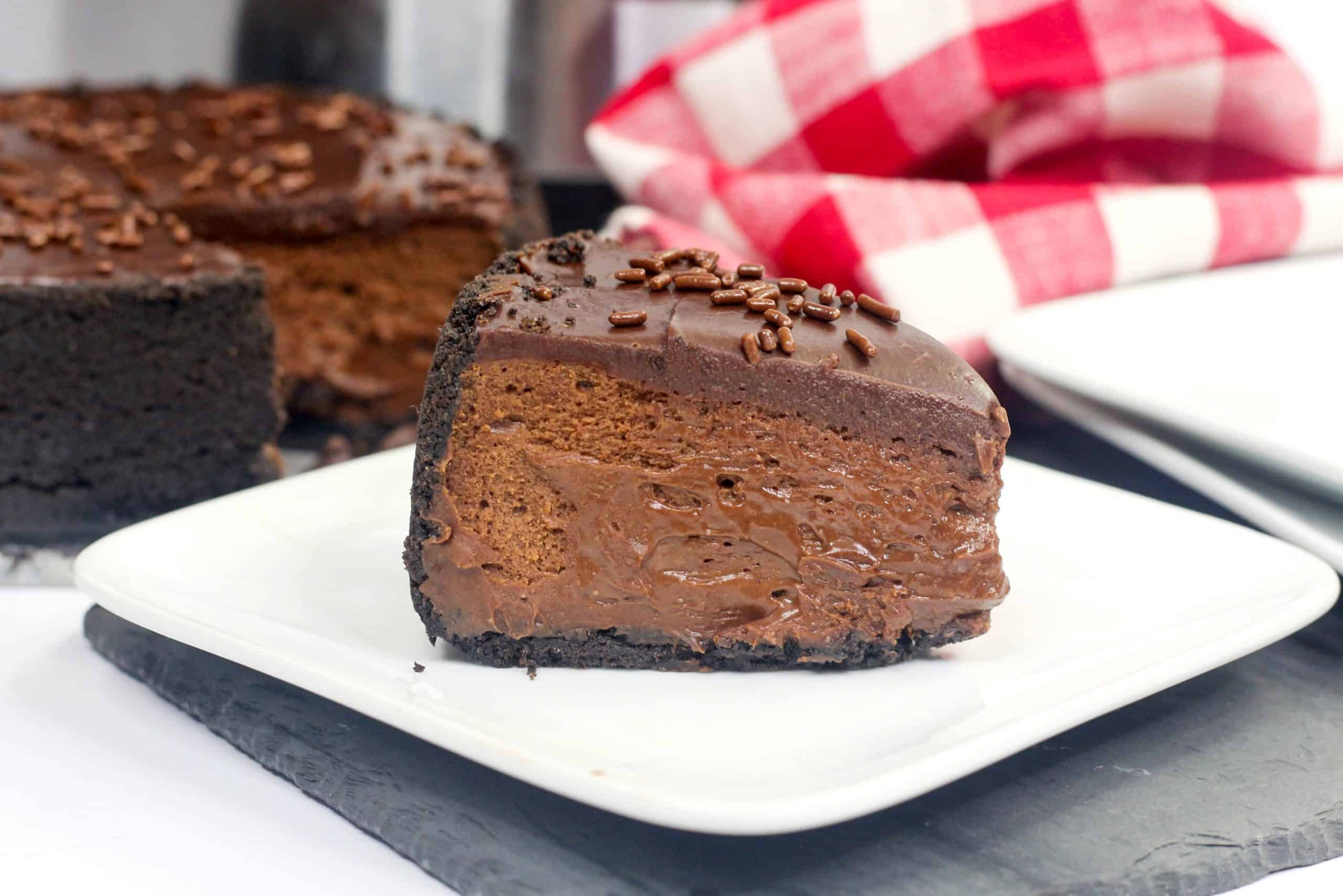 Slice of chocolate cheesecake on a white plate
