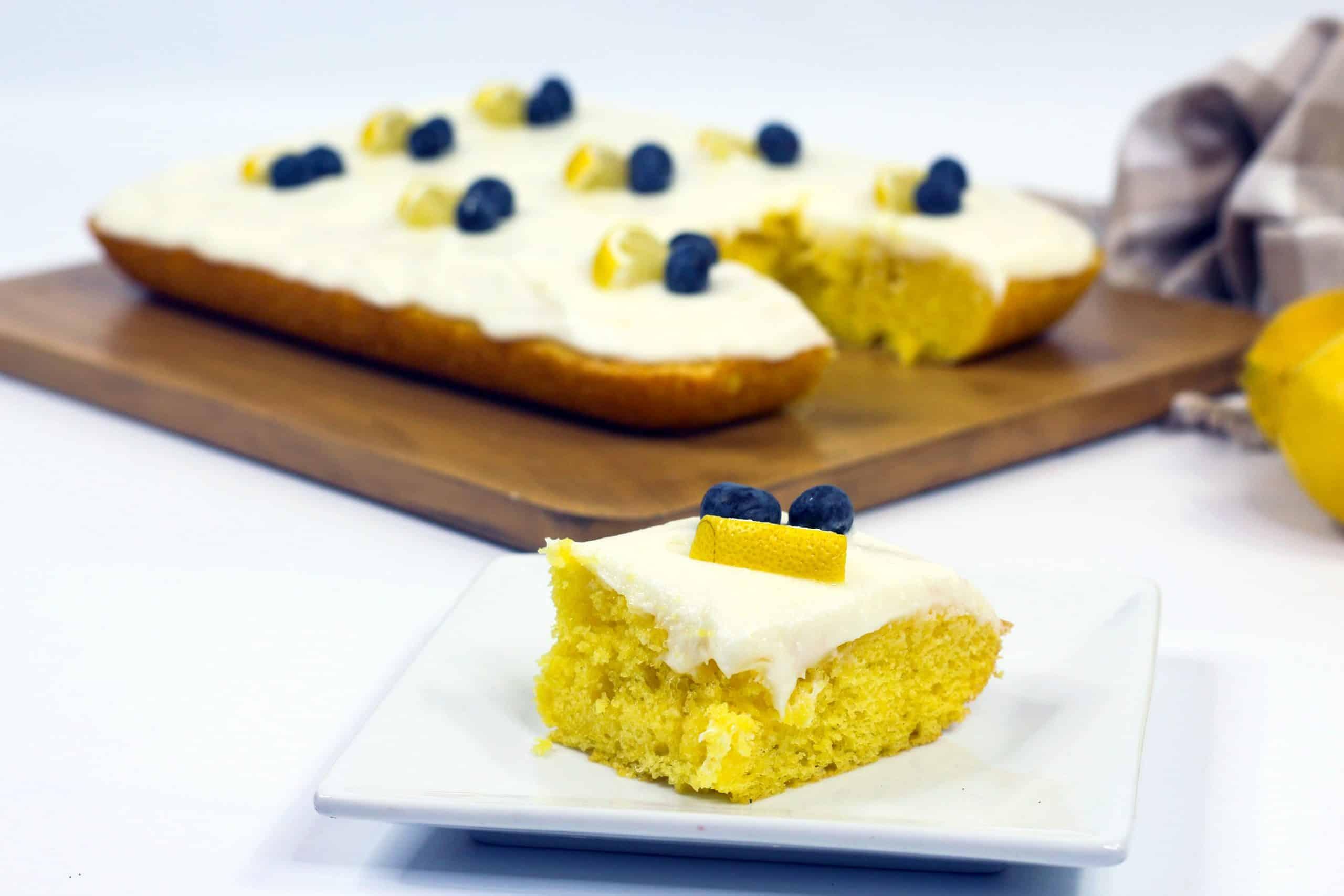 Slice of lemon sheet cake on plate