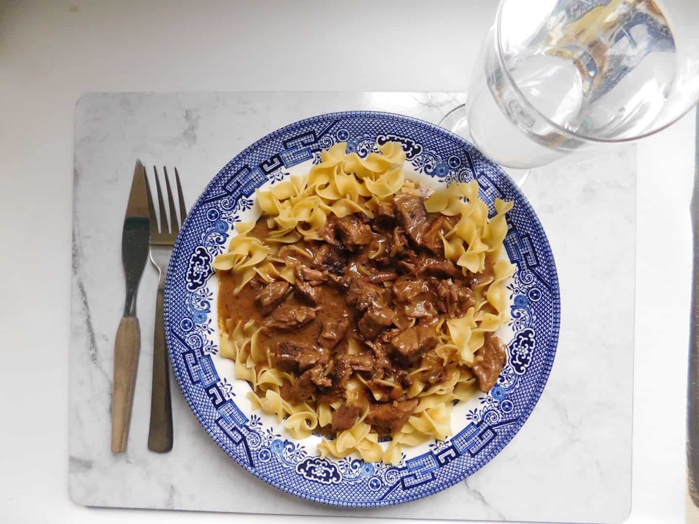 The coziest, creamiest beef tips with egg noodles